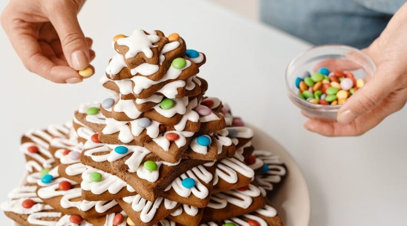 person decorating a stack of brown cookies(fast and easy recipes)
