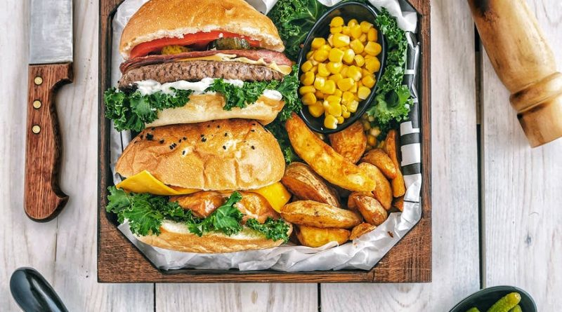 burgers with fries and tomatoes